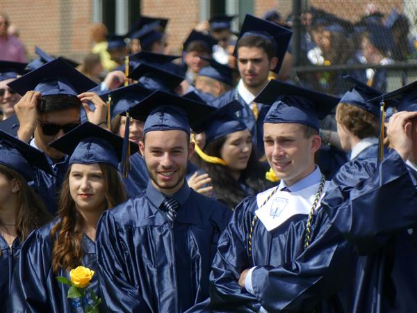 students line up at graduation