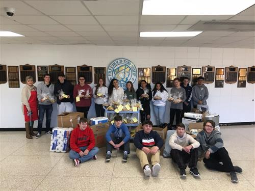 Family and Consumer Science students pose with the donated baked goods