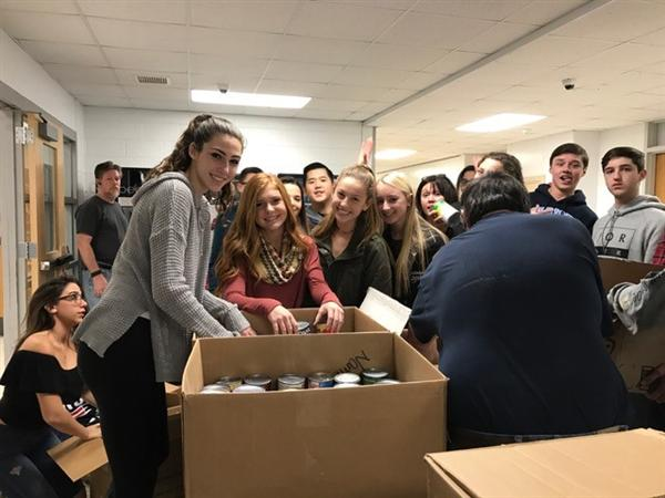 Students with the food collected
