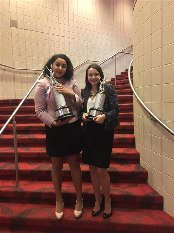 Tierney and Ally with their trophies