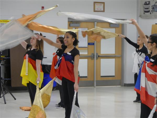 students dance with flags