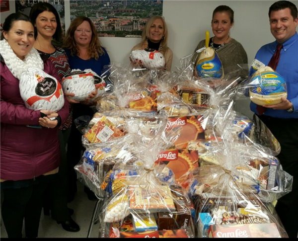 RAISE faculty members with their Thanksgiving gift baskets