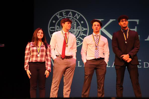 DECA winners on stage