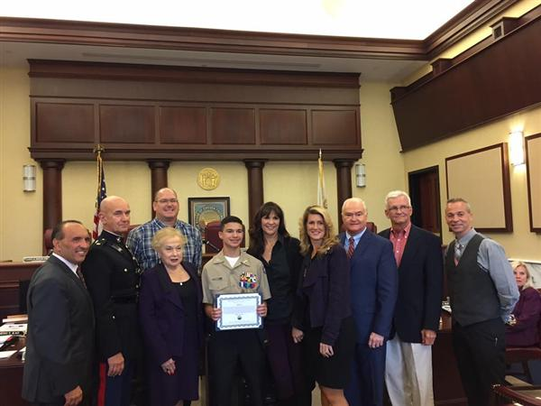 William Dean receives a certificate of recognition from the county freeholders