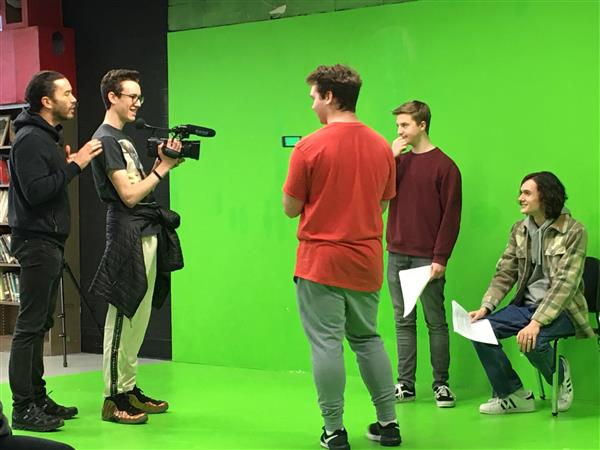 Tom Pelphrey working with students on a scene