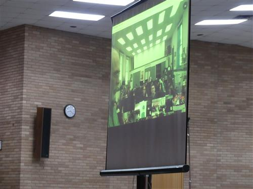 Freehold High School is seen on the screen during the Virtual Concert
