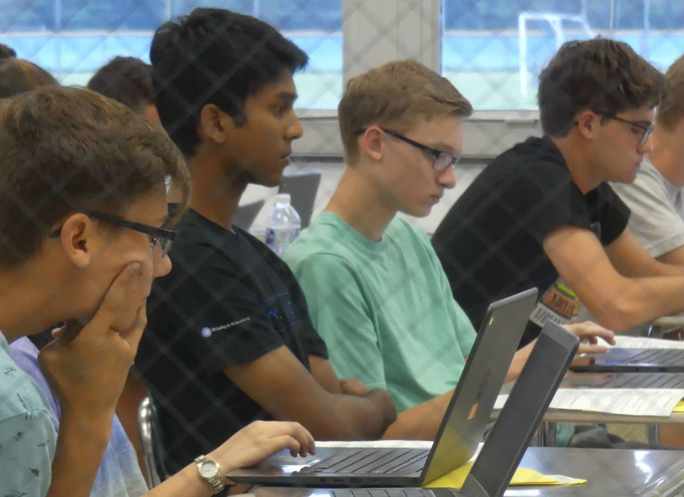students listen during a discussion on college planning