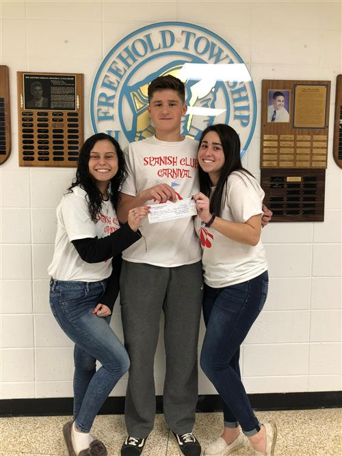 Liz Acque, Angelise Vera and Mike Poleschuk raised $2,770 for a school in Puerto Rico