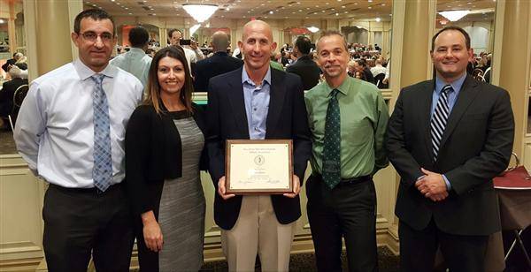 Coach Doug Phillips receives the NJSIAA Sport Award for Soccer