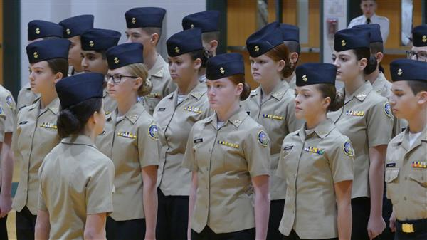 A group of freshmen cadets stand at attention