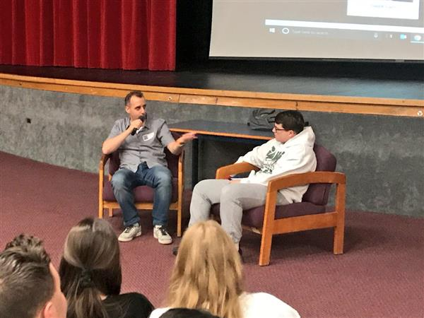 Joe Gatto speaks during interview at Manalapan High School