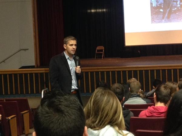 Josh Welle meets with students