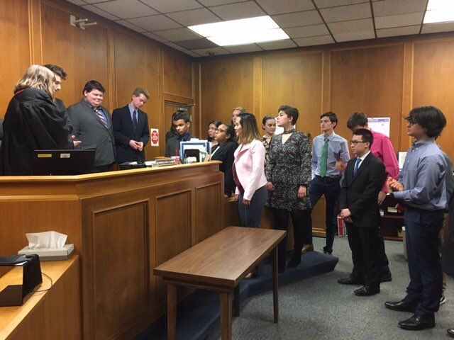 mock trial team in courtroom