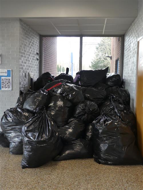 The overflowing pile of donated coats