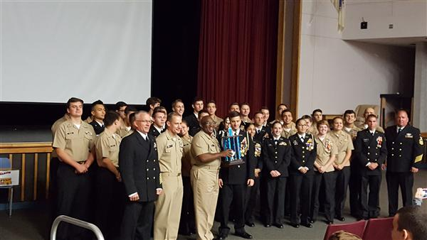 The Navy Junior ROTC Unit receives its trophy