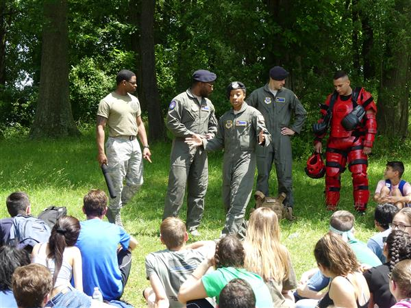 air force members speak with students