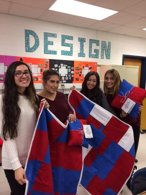 Students display their quilts