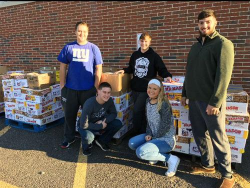 Students with the food to be donated
