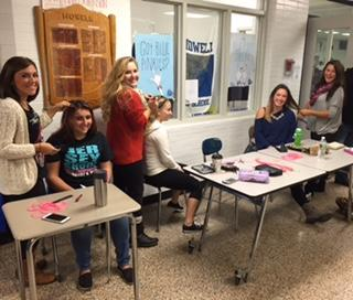 Howell students receive pink hair extensions for Breast Cancer Awareness Month