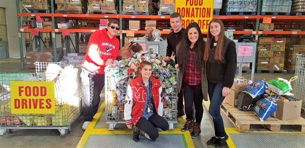 National Honor Society members with Manalapan's donations