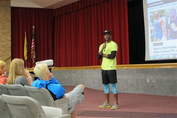 Nate Burleson speaks with students